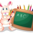 A bunny with coloring pens beside a blackboard — Stock Vector