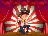 A boy kneeling at the center of the stage — Stock Vector