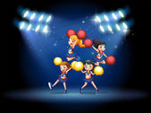 A stage with a cheerleading squad — Stock Vector