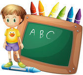 A boy beside a board with crayons at the back — Stock Vector