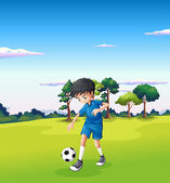 A boy playing soccer at the forest — Stock Vector