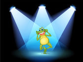 A frog smiling in the middle of the stage — Stock Vector