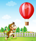 A monkey running outside the fence with a hot air balloon — Stock Vector
