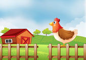 A hen at the field with a barnhouse — Stock Vector