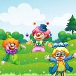 Three clowns at the garden — Stock Vector