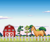 A horse inside the fence with a barn — Stock Vector