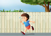 A little boy running at the road — Stock Vector