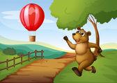 A bear running after the hot air balloon — Stock Vector
