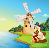 A duck reading a book near the windmill — Stock Vector