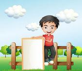 A boy holding an empty framed signboard — Stock Vector