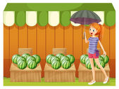 A girl in front of the watermelons — Stock Vector
