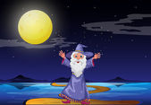 A wizard under the bright fullmoon — Stock Vector