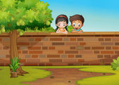 A girl and a boy leaning over the concrete fence — Stock Vector