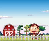 A monkey near the red barnhouse — Stock Vector