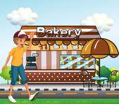 A boy walking across the bakery — Stock Vector