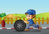 A boy wearing a hat pushing a wheel along the road — Stock Vector