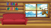 An empty sofa with bookshelves at the back — Stock Vector