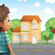 A young boy standing across the village — Stock Vector