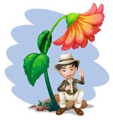 A boy sitting at the rock below a big flower — Stock Vector