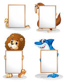 Four animals with empty whiteboards — Stock Vector