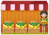 A girl selling pineapples — Stock Vector