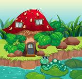 A worm near the red mushroom house — Stock Vector