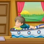 A sad little boy inside the house — Stock Vector #28832525