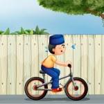 A tired boy biking — Stock Vector #28833599