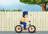 A tired boy biking — Stock Vector