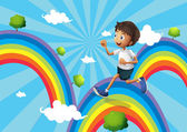 A boy running above the rainbow — Stock Vector