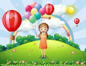 A girl holding balloons — Stock Vector