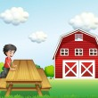 A boy at the table near the barnhouse — Stock Vector