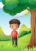 A boy under the shade of a big tree — Stock Vector