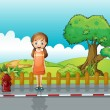 A small girl standing near the wooden fence — Stock Vector
