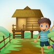 A boy waving his hand in front of a nipa hut — Stock Vector