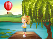 A girl standing above the wooden bridge with a hot air balloon n — Stock Vector
