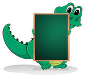 A small crocodile at the back of an empty greenboard — Stock Vector