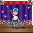 A boy and his bike at the center of the stage — Stock Vector