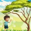 A happy boy near the tree — Stock Vector