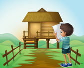A boy with a paper in front of the nipa hut — Stock Vector