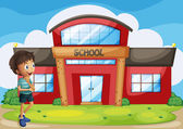 A boy in front of the school building — Stock Vector