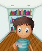 A young boy in front of the bookshelves — Stock Vector