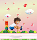 A boy exercising in the candyland — Stock Vector