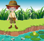 A serious looking boy at the riverbank — Stock Vector