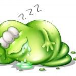 A greenslime monster sleeping — Stock Vector #30283509