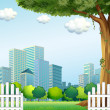 A giant tree near the wooden fence across the tall buildings — Stock Vector