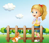 A girl near the fence with a rabbit — Stock Vector