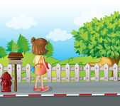 A girl standing near the mailbox at the roadside — Stock Vector