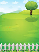 A giant tree at the hilltop — Stock Vector