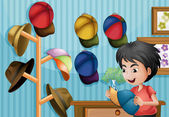 A young boy and his cap collection — Stock Vector